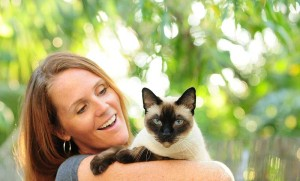 Woman holding cat | Cat Ownership increase in Kirkland Washington post by All About Cats Veterinary Hospital in Kirkland, WA